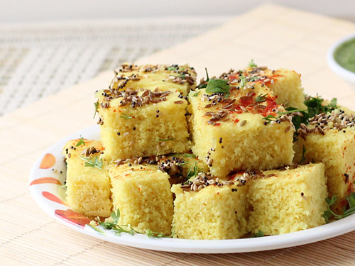 Khatta dhokla recipe traditional recipe to make spongy sour dhokla turn off flame and pour it over dhokla and mix well to coat dhoklas evenly with tempering transfer khatta dhokla to a serving plate and garnish with forumfinder Choice Image